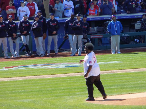 Questlove threw out the first pitch at the Phillies 2019 opening day game. (Ximena Conde/WHYY)