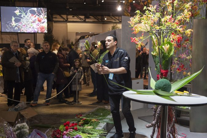 Vincenzo Antonuccio works on his arrangement while crowds watch. (Jonathan Wilson for WHYY)