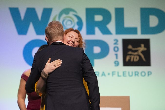 Second place winner Natalia Zhizhko of Russia is embraced by host Per Benjamin. (Jonathan Wilson for WHYY)
