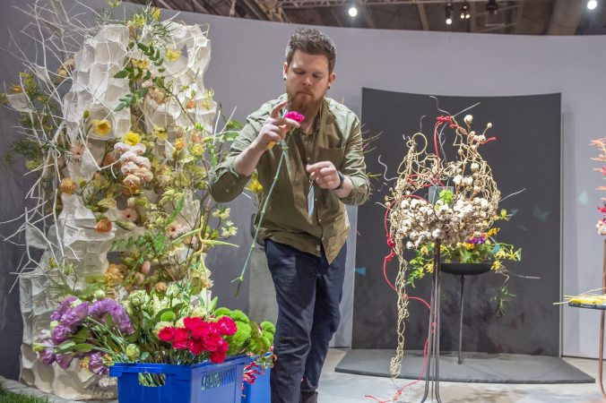 Stephan Tirbe, semi-finalist from Germany, inspect flowers at the start of the semi-final round of competition. (Jonathan Wilson for WHYY)