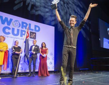 Declared the winner of the FTD Interflora World Cup Australia's Bart Hassam holds his trophy aloft and waves to the audience. (Jonathan Wilson for WHYY)