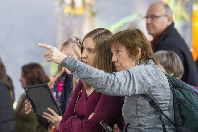 Jennifer Garton (left) and Jan Marcinkevich, from South Jersey, view the competition. (Jonathan Wilson for WHYY)