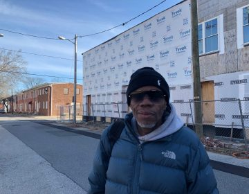 "Troy Curtis calls it a ""waste of money"" that homes being built and slated for renovation on Wilmington's East Side have languished without progress for months. (Cris Barrish/WHYY)"