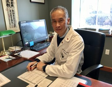 Dr. Immanuel K. Ho, MD,  Director of Interventional Endoscopy, in his office at Pennsylvania Hospital.  (Jennifer Lynn/WHYY)