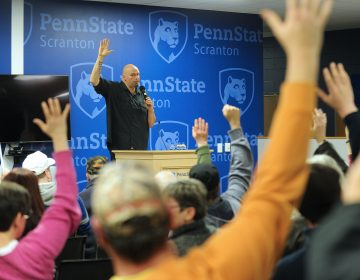 Pennsylvania Lt. Gov. John Fetterman asks for a show of hands with all in favor of adult recreational use marijuana at the conclusion of a listening session on recreational marijuana with community members Mar. 2, 2019, at Penn State Scranton in Dunmore, Pennsylvania. (Matt Smith for WHYY)
