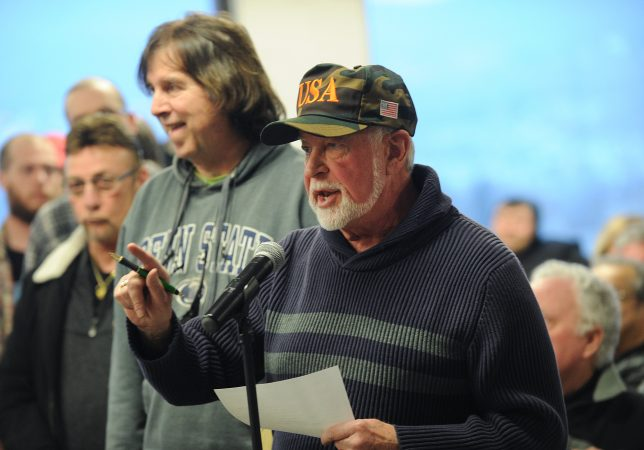 Bob Bolus, of Scranton, voices his disapproval with recreational use of marijuana during Fetterman's Lackawanna County stop. (Matt Smith for WHYY)