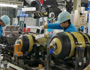 At Toyota's LFA Works factory in Japan, workers install hydrogen fuel tanks in a new Mirai. (Hiroo Saso)