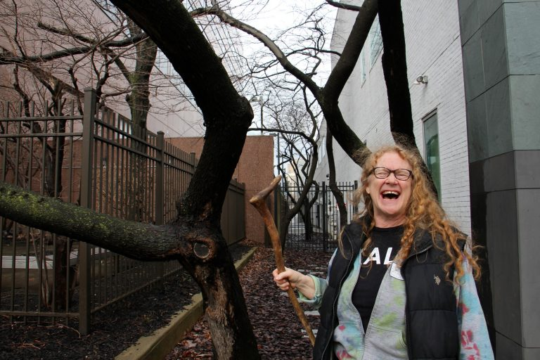 This Eastern redbud tree outside WHYY studios will bloom in a few weeks, and that thought delights Sally McCabe, associate director of community education at the Pennsylvania Horticultural Society. (Emma Lee/WHYY)
