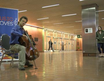Philadelphia Orchestra cellist Bob Cafaro performs at Jefferson Station in Philadelphia as part of the