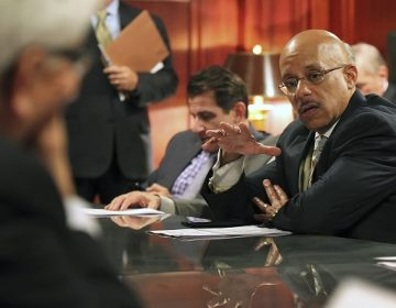 Sen. Vincent Hughes, D-Philadelphia, makes a point as they discuss pension legislation in the Rules Committee ahead of floor debate at the state Capitol in Harrisburg, Pa., Tuesday, June 30, 2015. (Chris Knight/AP Photo)