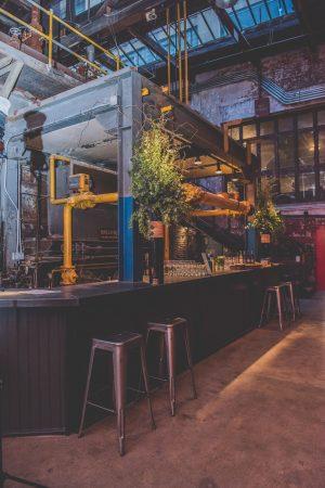 A bar wraps around original pipework. (Courtesy of Birchtree Catering/BeauMonde Originals)
