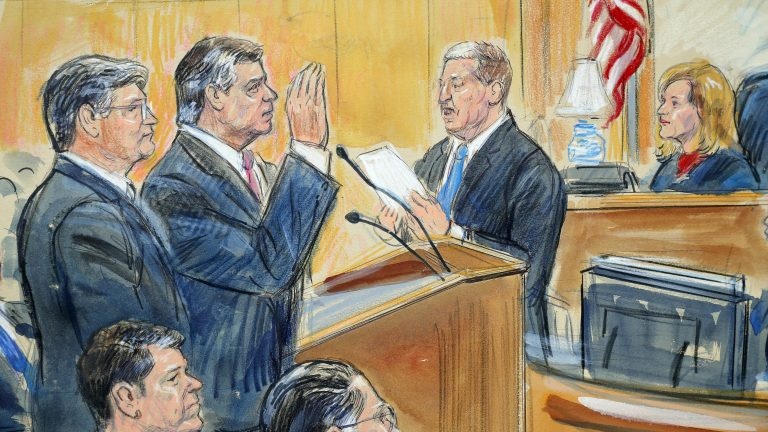 This courtroom sketch depicts former Donald Trump campaign chairman Paul Manafort (center) before U.S. District Judge Amy Berman Jackson in September 2018. She is scheduled to sentence Manafort on Wednesday. (Dana Verkouteren via AP)