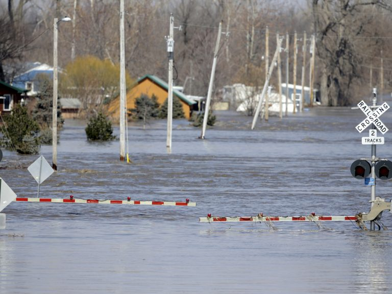 A railroad crossing is flooded with water from the Platte River in Plattsmouth, Neb. Record high floodwaters inundated regions of the Midwest following an intense winter storm and rapid snowmelt. (Nati Harnik/AP Photo)