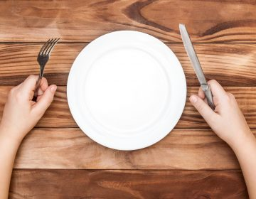 Hungry Child Waiting For Meal. Child's Hands Holding Fork And Kn