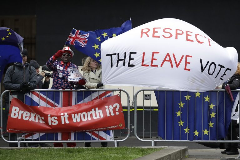 Pro-Brexit leave the European Union supporters and anti-Brexit remain in the European Union supporters take part in a protest outside the Houses of Parliament in London, Tuesday, March 12, 2019. British Prime Minister Theresa May faced continued opposition to her European Union divorce deal Tuesday despite announcing what she described as