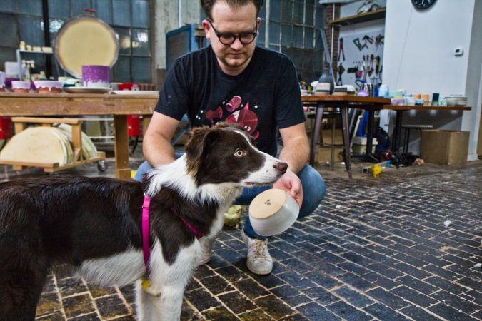 Brian Giniewski and his dog Jelly who has her own line of dog bowls. (Kimberly Paynter/WHYY)