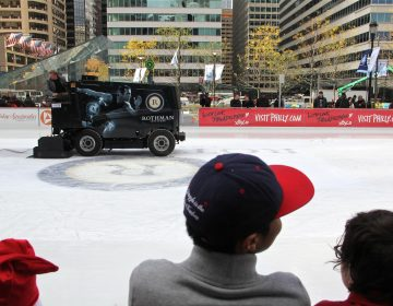 A zamboni puts a fresh gloss on the Dilworth Plaza ice rink.