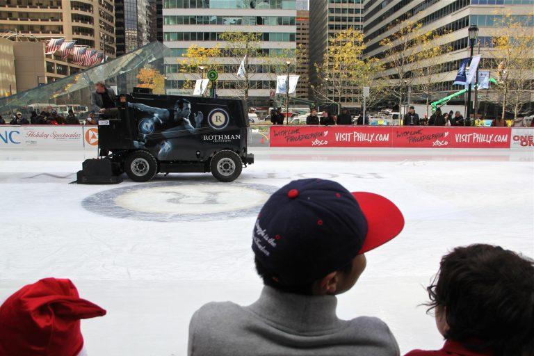 A zamboni puts a fresh gloss on the Dilworth Plaza ice rink.
