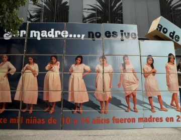 A billboard built by sex education advocates outside Mexico's National Population Council office, in Mexico City, warns that 'being a mother is not child's play.' (Rebecca Blackwell/AP Photo)
