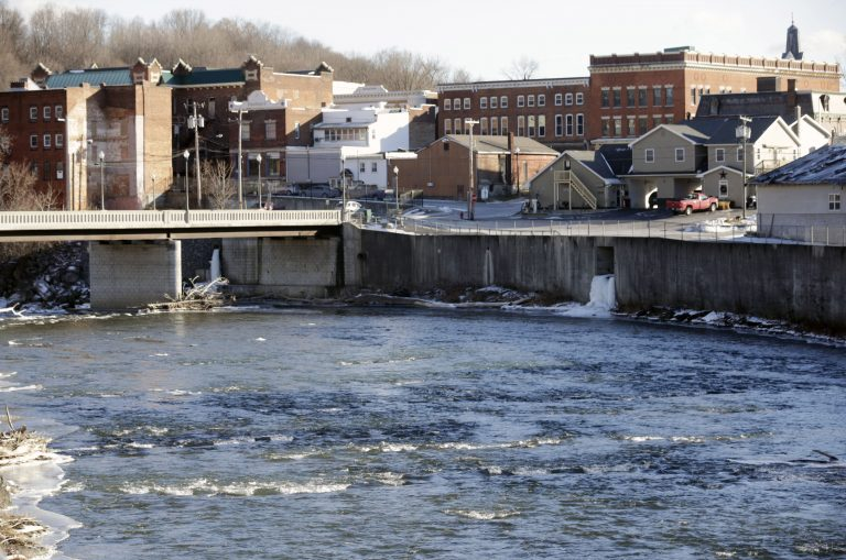 In this Jan. 21, 2016 file photo, the Hoosic River runs through the village of Hoosick Falls, N.Y. No higher incidences of certain types of cancer linked to the toxic chemical PFOA were found in the upstate New York village whose water supplies were contaminated by the chemical, state health officials said in a report released Wednesday, June 7, 2017. (Mike Groll/AP Photo)