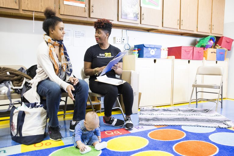 Jabina Coleman (right) introduces herself to Pamela Newman and  3-month-old James at the Lucien E. Blackwell library. Coleman leads a breastfeeding class and co-runs the Prenatal Mental Health Alliance for Women of Color. In  February, some mothers described experiencing postpartum depression. (Rachel Wisniewski/ For the Philadelphia Inquirer)