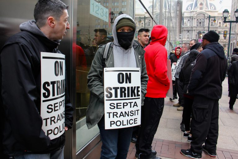 About 30 SEPTA police officers picket outside SEPTA headquarters at 1234 Market Street. (Emma Lee/WHYY)