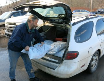 John Ord of Susquehanna, Pa., loads 40-pound bags of anthracite coal into his car. He's among the fewer than 130,000 households left in the United States that burn coal to heat their homes. (Jeff Brady/NPR)