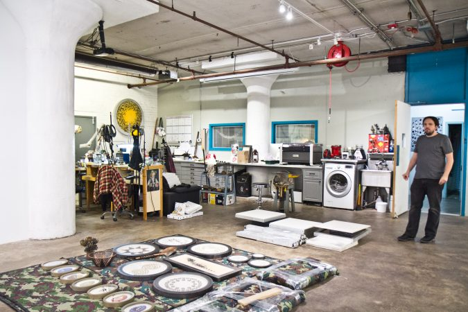 The living space of artists tacky Lee Webber and Joseph Leroux is attached to their studio spaces at the Globe Dye Works building. (Kimberly Paynter/WHYY)