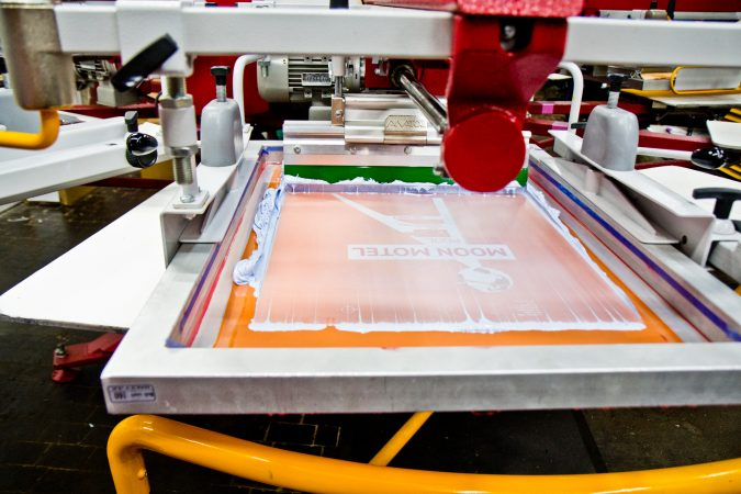 A screen printing work in progress at Pink's Inks located in the Globe Dye Works building. (Kimberly Paynter/WHYY)
