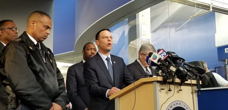 Pennsylvania Attorney General Josh Shapiro speaks to reporters with Police Commissioner Richard Ross (left) and District Attorney Larry Krasner at his side (Tom MacDonald/WHYY)