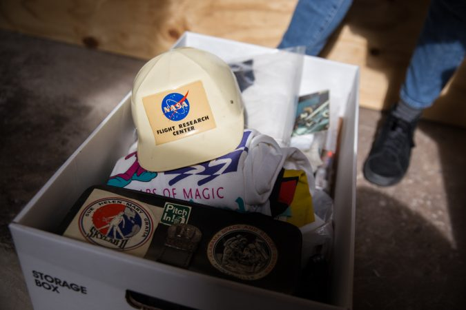 "In addition to print photographs, the ""space junk"" collection includes, t-shirts, pins, buttons, patches, historical documents, stamps, ""space bits"" and other memorabilia.  (Lindsay Lazarski/WHYY)"