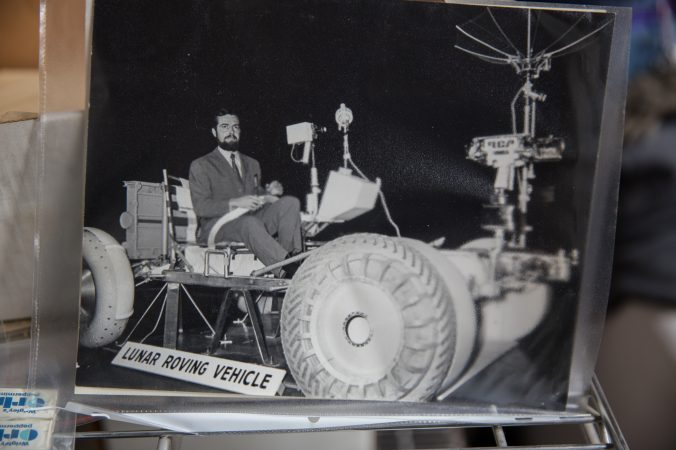 Jacques Tiziou, a french journalist who documented the space program, seen testing out a lunar rover. (Lindsay Lazarski/WHYY)