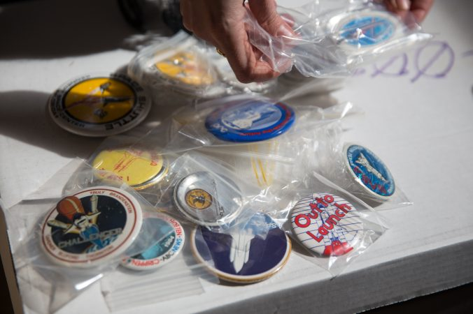 Pins and buttons from French journalist Jacques Tiziou's collection of memorabilia from the space program. (Lindsay Lazarski/WHYY)