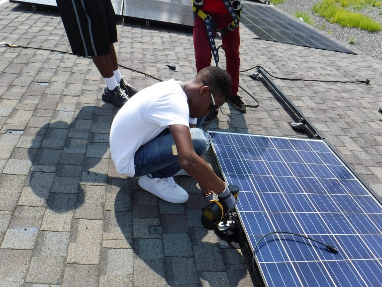 Student trainees receive hands-on experience in solar installation under the supervision of practitioners provided by Philadelphia-based company Solar States. (Courtesy of the Philadelphia Energy Authority)