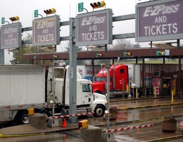 Trucks and cars move through a Pennsylvania Turnpike toll plaza in Carlisle. (Carolyn Kaster/AP Photo)