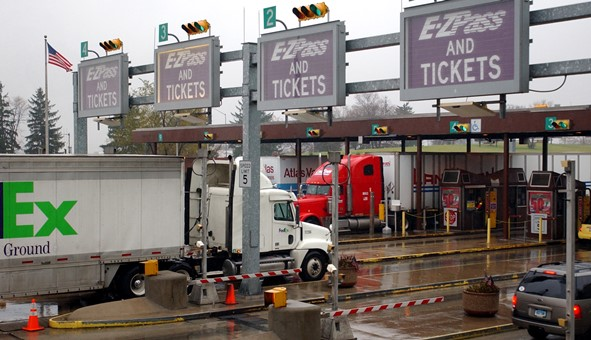 Trucks and cars move through a Pennsylvania Turnpike toll plaza in Carlisle
