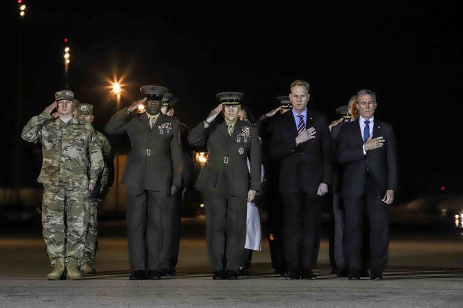Members of the official party Gov. John Carney, Sgt. Major of the Marine Corps Ronald Green, Commander of the Marine Corps Gen. Robert Neller, acting Secretary of Defense Patrick M. Shanahan and Air Force Col. Matthew Jones, 436th Airlift Wing, Vice Commander attend the dignified transfer of Staff Sgt. Christopher K.A. Slutman at Dover Air Force Base Thursday, Apr. 11, 2019. (Saquan Stimpson for WHYY)