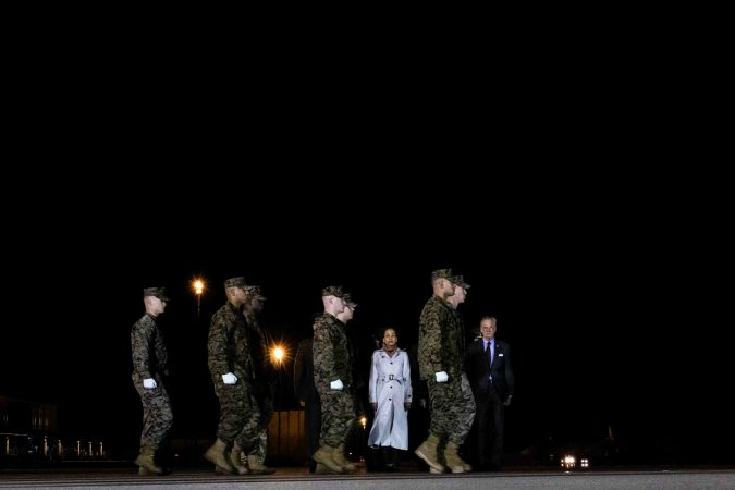 A U.S. Marine Corps carry team walks to the remains of Staff Sgt. Christopher K.A. Slutman during a dignified transfer at Dover Air Force Base Thursday, Apr. 11. (Saquan Stimpson for WHYY)