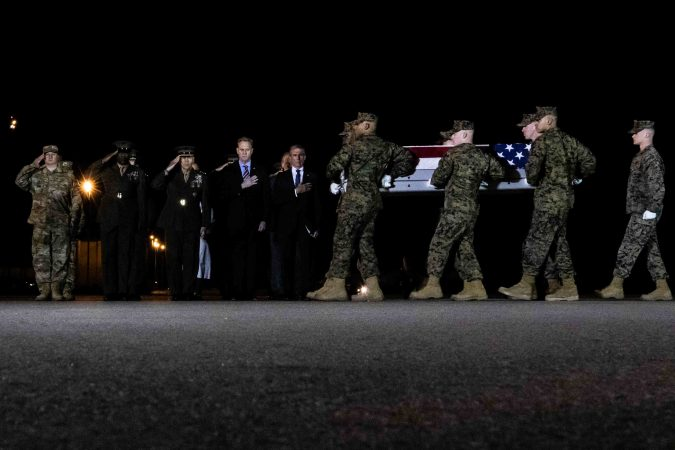 U.S. Marines carry the remains of Staff Sgt. Christopher K.A. Slutman during a dignified transfer at Dover Air Force Base Thursday, Apr. 11, 2019. (Saquan Stimpson for WHYY)