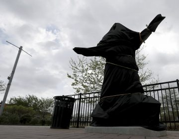 The covered Kate Smith statue sits outside Wells Fargo Center in Philadelphia on Friday, April 19, 2019. (David Maialetti/The Philadelphia Inquirer via AP)