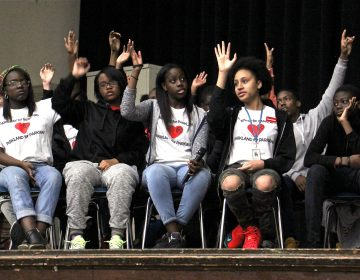 Students at Philadelphia's Parkway Center City Middle College were asked to raise their hands if they were affected by gun violence at an April 2018 forum. (Emma Lee/WHYY)