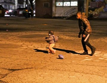 Maurice Barnes plays in the schoolyard behind Lowell Elementary School in Philadelphia. (Kimberly Paynter/WHYY)