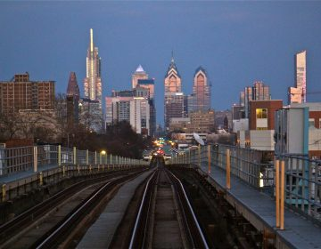 A view of the Philadelphia skyline from the Market-Frankford elevated line in West Philadelphia. (Emma Lee/WHYY)