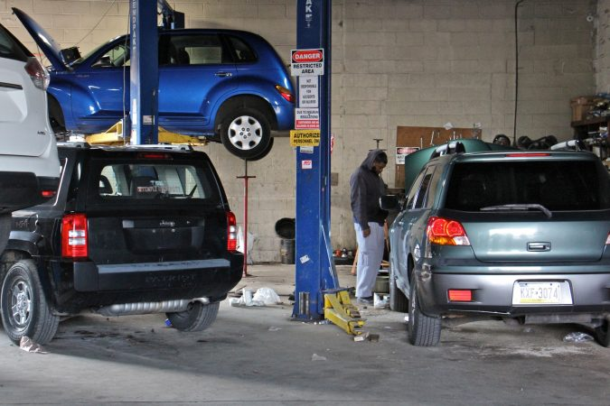 Fasu's Auto repair appears to be in compliance with health and safety regulations. (Emma Lee/WHYY)