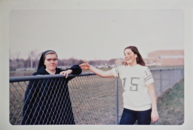 Patricia Cahill (right) greets Sister Eileen Shaw, the nun she says sexually abused her, at an event at Paramus Catholic High School in 1970. (Courtesy of Patricia Cahill)