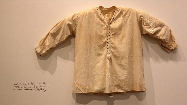 Sara's father's embroidered undershirt is one of many intimate objects and stories passed down through the generations. (Emma Lee/WHYY)
