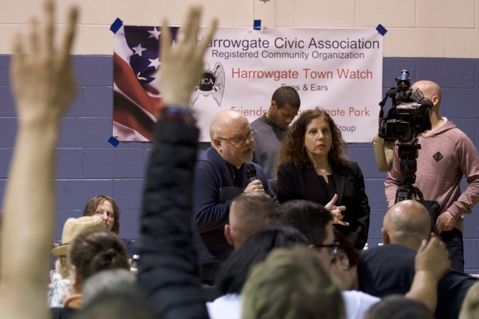 Jose Benitez, Director of Prevention Point and Ronda Goldfein, represent Safehouse during a community meeting at the Heitzman Rec Center on Thursday night. (Bastiaan Slabbers for WHYY)