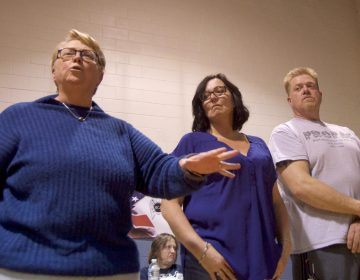 A group of leaders from the local community speak out against plans for a supervised injection facility during a community meeting at the Heitzman Rec Center on Thursday night. (Bastiaan Slabbers for WHYY)