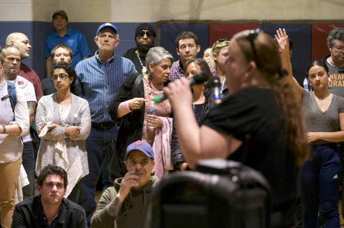 Representatives of Safehouse respond residents who voiced their questions and concerns over plans for a supervised injection facility during a community meeting at the Heitzman Rec Center on Thursday night. (Bastiaan Slabbers for WHYY)
