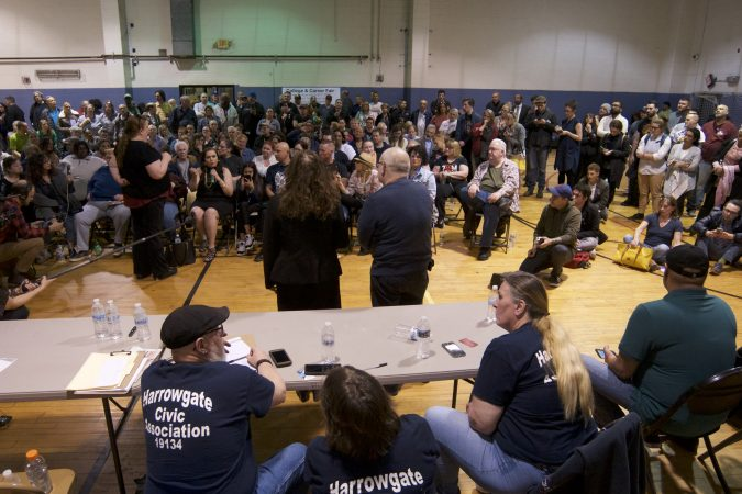 Representatives of Safehouse respond to questions and concerns about plans for a supervised injection facility in the neighborhood during a community meeting at the Heitzman Rec Center on Thursday night. (Bastiaan Slabbers for WHYY)